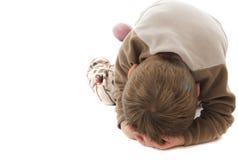 Toddler temper tantrum. Toddler on floor with head in hands having a temper tantrum stock images