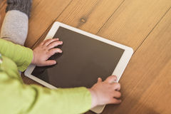 Toddler touching tablet Stock Photo