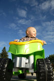 Toddler on a toy ATV Royalty Free Stock Photo