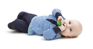 Toddler with toy on floor Stock Photo