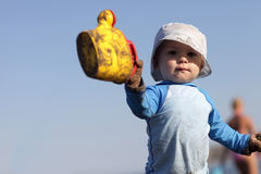 Toddler with toy watering can Royalty Free Stock Photos