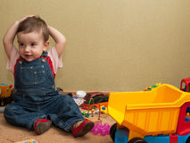 Toddler with toys Stock Photos