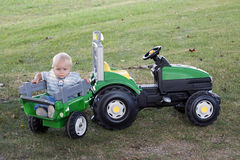 Toddler with tractor Royalty Free Stock Photography