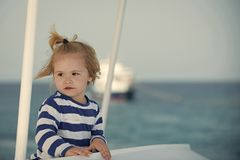 Toddler traveler. Boy little kid with cute serious face sailing on ship. Toddler traveler. Boy little kid with cute serious face sailing on white ship. Summer stock image