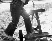 Toddler with a tricycle. B&w close-up of toddler with a tricycle Royalty Free Stock Images