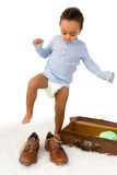Toddler trying Dad's shoes Royalty Free Stock Photos