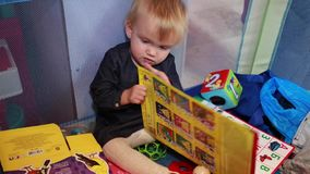Toddler turning pages book stock footage