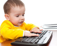 Toddler typing on the keyboard Royalty Free Stock Photos
