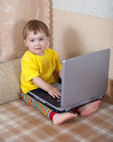 Toddler using laptop Stock Images