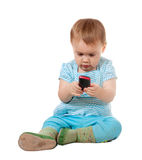 Toddler using mobile phone Stock Image