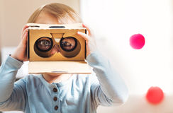 Toddler using a new virtual reality headset Royalty Free Stock Images