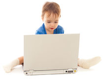 Toddler is using notebook isolated Royalty Free Stock Image