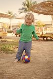 Toddler on vacation need entertainment. Resort hotel provides entertainment for children. Kid child play with ball alone. Boy cute want to have fun. Baby boy stock photography