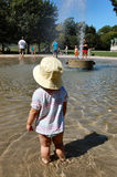 Toddler in wading pool. Toronto.  Canada Stock Photos