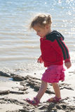 Toddler walking along lake Royalty Free Stock Images