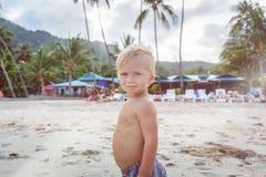 Toddler walking on a beach Stock Photos