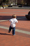 Toddler Walking on Bricks Royalty Free Stock Images