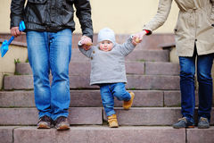 Toddler walking with his parents Royalty Free Stock Images