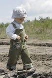 Toddler walking outdoors. Male toddler in sunhat walking outdoors Stock Photos