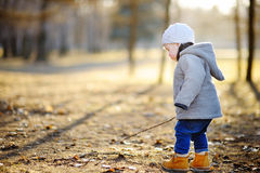 Toddler walking outdoors at the spring day Royalty Free Stock Images