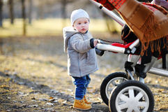 Toddler walking outdoors at the warm spring day Royalty Free Stock Image