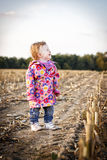 Toddler walking on the stubble field Royalty Free Stock Photos