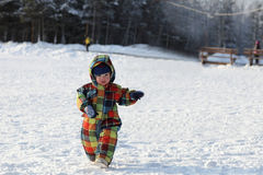 Toddler walking in winter park Royalty Free Stock Photography