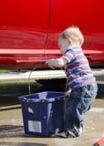 Toddler washing a car Royalty Free Stock Photography