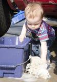 Toddler washing car Royalty Free Stock Photography