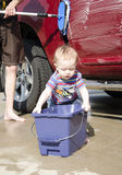 Toddler washing a car Royalty Free Stock Image
