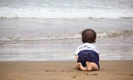 Toddler watching the ocean Stock Image