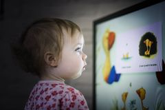 Toddler watching television royalty free stock images