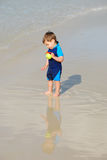 Toddler in water by the beach Stock Photography