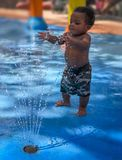 Toddler at Water Park. African American toddler plays with water at the Lowry Park Zoo in Tampa, Florida. Image taken on August 11, 2017 royalty free stock image