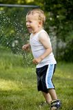 Toddler and water splash Royalty Free Stock Photography
