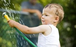 Toddler and water splash Stock Photos
