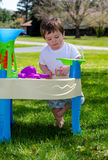 Toddler and water table stock photo