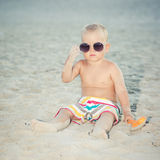 Toddler wearing oversized sunglasses Stock Photos
