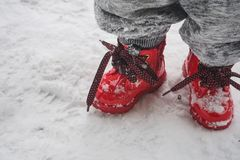 Toddler Wearing Red Shoes Standing On Snow Royalty Free Stock Photos