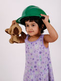 Toddler wears hard hat Stock Photography