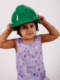 Toddler wears hard hat Stock Photos