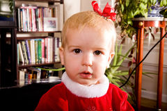 Toddler With Bow By Books Royalty Free Stock Photos