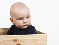 Toddler in wooden box Stock Photo