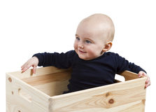 Toddler in wooden box Royalty Free Stock Photos