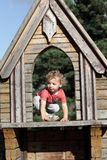 Toddler at wooden house Royalty Free Stock Photos