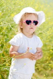 Toddler in the yellow rape field Stock Image