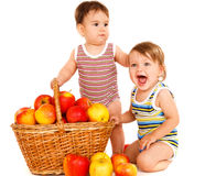 Toddlers with fruit basket Stock Images