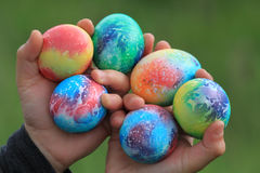 Toddlers hands holding easter eggs Royalty Free Stock Photos