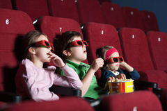 Toddlers in the movie royalty free stock photography