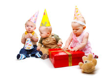 Toddlers in party hats Royalty Free Stock Images